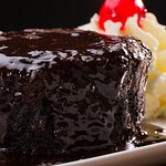 Chocolate dessert smothered in a decadent chocolate sauce