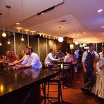 Queen City Room: holds up to 75 guests, 4 private lanes, private bar, and a pool table.