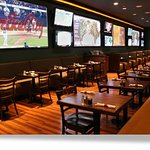 65+ HDTVs and the largest sports ticker around!