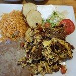Huevos en Machaca -- scrambled eggs with shredded beef, rice, beans, sliced potatoes, corn torti