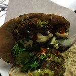 Freshly fried falafel with a whole bar of condiments. Order a bowl or pita. Delish.