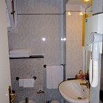 Spotless, albeit small, bathroom with bidet and shower