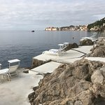Private beach looking over boat dock to Dubrovnik