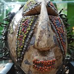 Old African mask used as passport