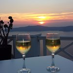 A glass of wine made in santorini at sunset