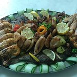 Grilled squid, prawns and fish of the first category