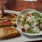 Grilled cheese lunch special with a caesar salad.