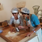 Nuncia and Nuncia showing us how to get the flour ready for our pasta