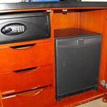 Safe and refrigerator under the TV.
