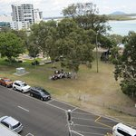 From balcony, down to front street and Cotton Tree Park, ocean in background.