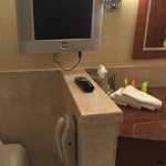Phone TV and lighted vanity mirror in the bath are nice touches. The room is large and inviting.