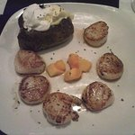 Pan Seared Scallops, baked potato with butter and sour cream, and chopped mango.