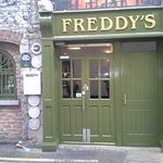Freddys set in rustic Coach House