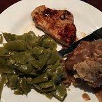 Pork chop, green beans and cornbread dressing.