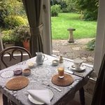 Breakfast table looking out at the garden