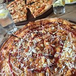Chicken Pizza and Sea Food Pizza in the back ground