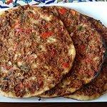 Sfahi (Armenian thin crust pizza with minced lamb meat)