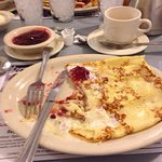 Delicious Swedish pancakes with Lindenberry sauce in the side