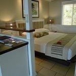 Bure included bedroom, shown, lounge area, bathroom and veranda.