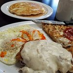 Chicken fried steak, eggs over easy with my added hot sauce, hash browns and pancakes.  All deli