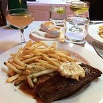 Our famous Steak Frites and a cocktail.