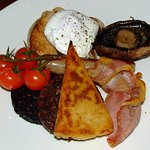 Poached egg, toast, smoked bacon, sausage, black pudding, haggis, tattie scone, mushroom & tomat