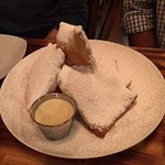 Beignets with powdered sugar and creme anglaise