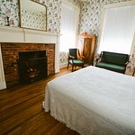 The John Anderson Room offers a spacious coziness with it's fireplace and king sized bed.