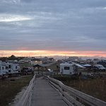 view of the campground from the ocean dunes at sunset