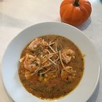 Great place to get local, fresh seafood in a charming spot. The shrimp and grits with frizzed le