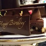 The delicious chocolate cake with a Happy Birthday slab of chocolate!