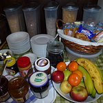 Cereal, fresh fruit, toast, criossants, jams, spreads.