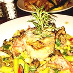 yellowfin tuna on house made pasta with seasonal veggie medley fried shrimp in background