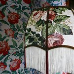 bold wall paper and vintage lamp