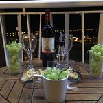 our balcony with local wine&grapes from convinience store and some treats from the hotel