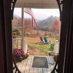 look out the front door to the mountains, spacious yard and comfortable front porch area