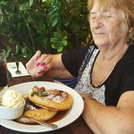 My mum enjoying her pancakes,she is o holiday so she can have dessert for lunch