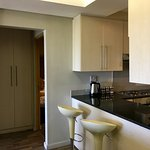 Genesis Suites - Kitchen, and bedrooms
