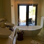 Lion Sands - bathroom with patio outside