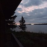 Moose visits the Rock Harbor Lodge. Sunrise view from a guest room in the Rock Harbor lodge.