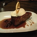 Warm apple pecan cake with whipped cream and light butterscotch sauce. Perfect level of sweetnes
