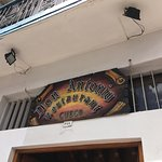 The sign above the restaurant entrance