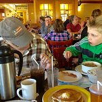 7-year-old eats breakfast with Grandma