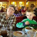 7-year-old eats oatmeal with Grandma