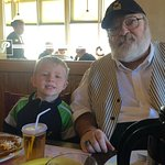 5-year-old eats breakfast with Grandpa.