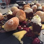 Sugar dusted donuts with lemon curd and chocolate