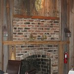 Fireplace inside dining room.