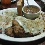 The Cowboy Chicken Fried Steak with garlic mashed potatoed and beans
