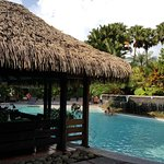 One of the pools on the resort property. The breakfast buffet is served inside this palapa.