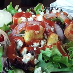My salad with blue cheese crumbles and French dressing